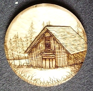 Relief Carving of Cabin by the Lake